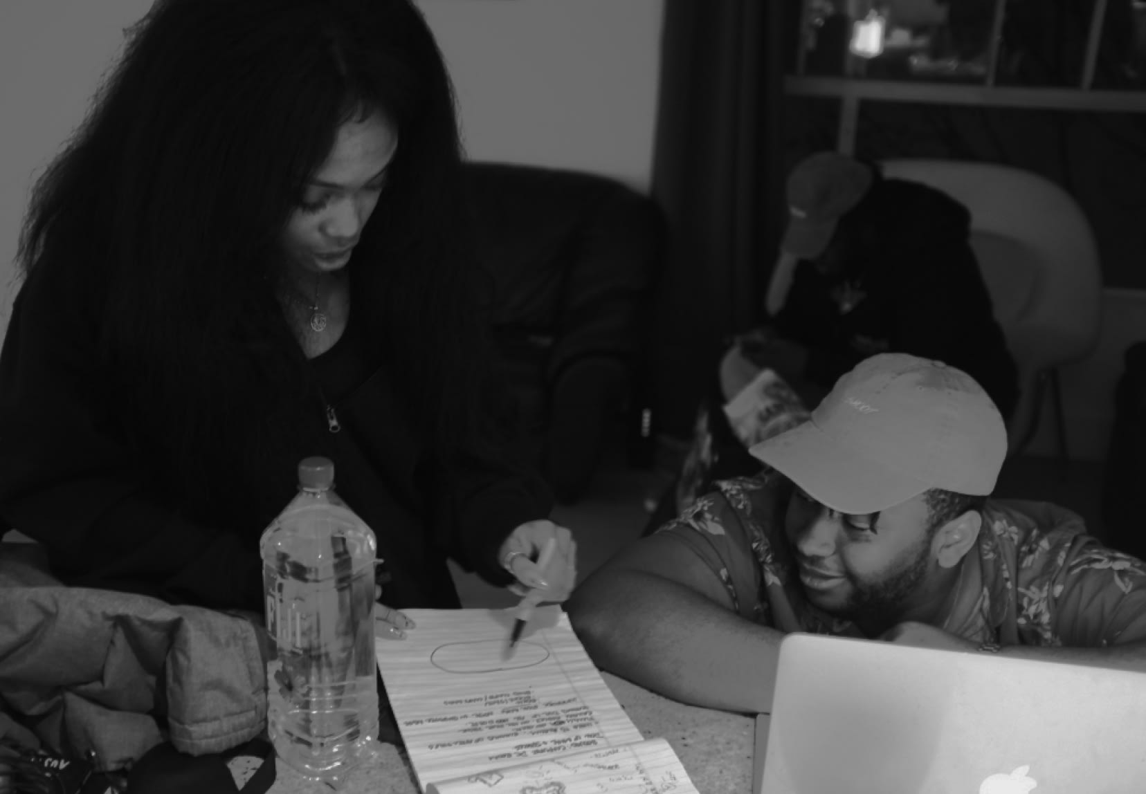 SZA working on a design on paper.